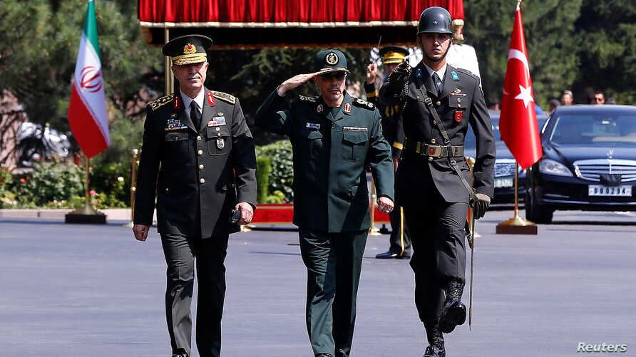 Turkish Chief of Staff General Hulusi Akar and his Iranian counterpart Major General Mohammad Baqeri review the guards of honor during a welcoming ceremony in Ankara, Turkey, Aug. 15, 2017.