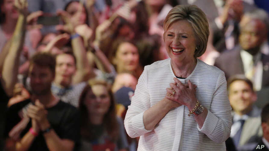 Having made history, presumptive Democratic presidential nominee Hillary Clinton arrives at a presidential primary election night rally on June 7, 2016, in New York. (AP)