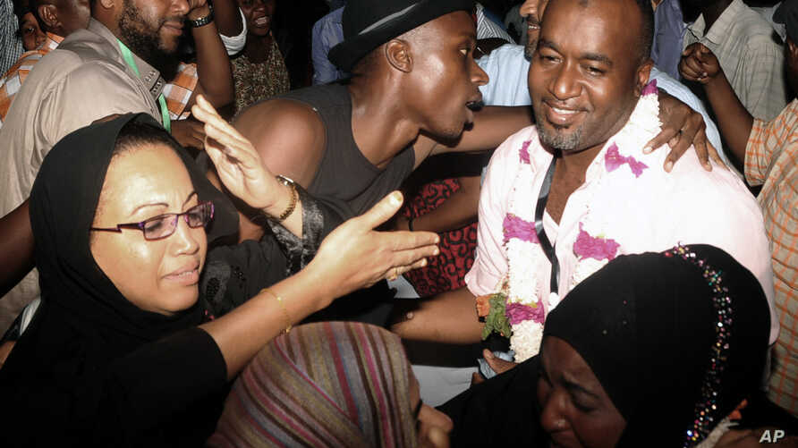 FILE - Mombasa County Governor elect Hassan Ali Joho, right, of the Coalition for Reforms and Democracy (CORD) party, is congratulated by some of his supporters after the IEBC declared him the winner to become the first Governor for Mombasa town, Mar
