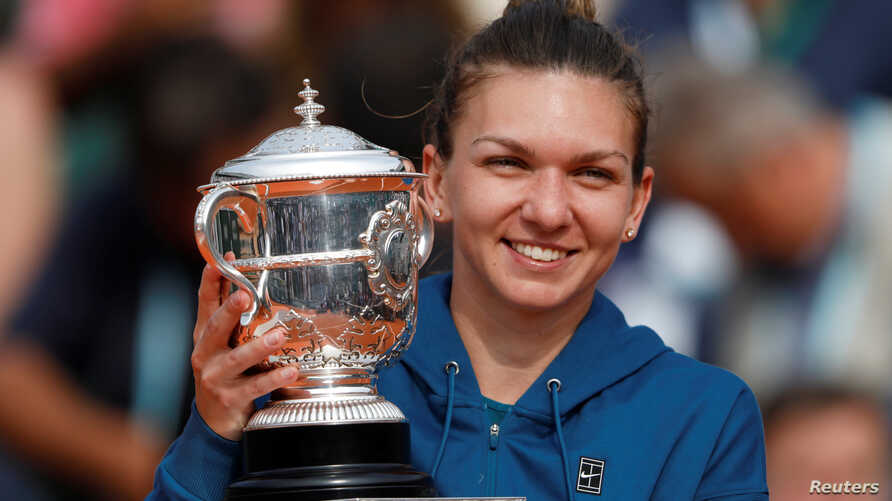 Romania's Simona Halep celebrates with the trophy after winning the French Open final against Sloane Stephens of the U.S. at Roland Garros, Paris, June 9, 2018.