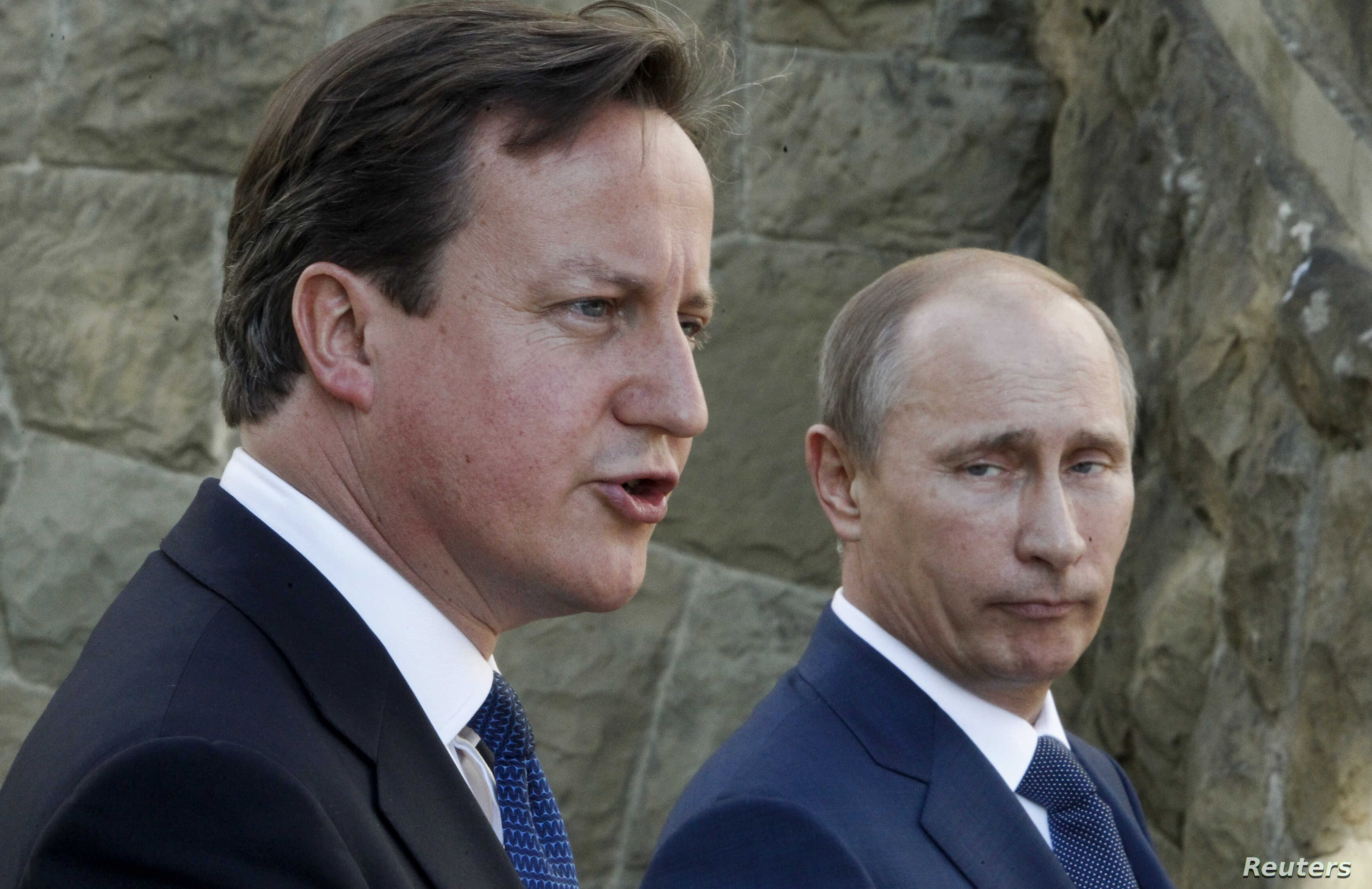 Britain's Prime Minister David Cameron and Russian President Vladimir Putin (R) speak to media after their meeting at the Bocharov Ruchei state residence in Sochi May 10, 2013.