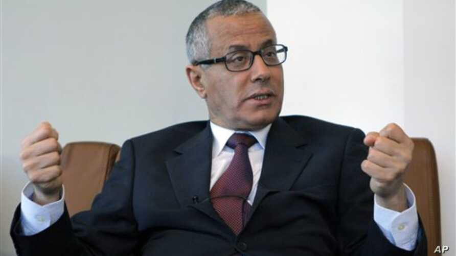 Ali Zeidan, a Europe-based envoy for the Libyan National Transitional Council, speaks to the Associated Press in Paris, Monday March, 21, 2011. Zeidan said air strikes, led by France, Britain and the United States, have helped, but the council do not