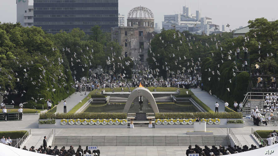 FILE - In this Aug. 6, 2013 file photo, doves fly over the cenotaph dedicated to the victims of the atomic bombing at the Hiroshima Peace Memorial Park during a ceremony marking the 68th anniversary of the bombing, in Hiroshima, western Japan.