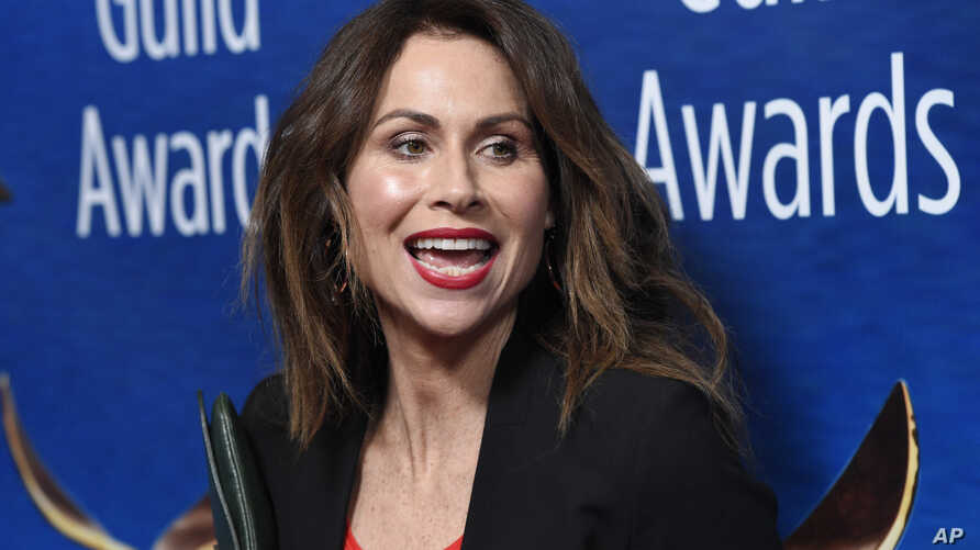 Actress Minnie Driver poses at the 2018 Writers Guild Awards at the Beverly Hilton on Sunday, Feb. 11, 2018, in Beverly Hills, California.