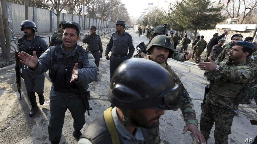 Security forces inspect the site of an Islamic State-claimed attack on a hospital in Kabul, Afghanistan, March 8, 2017.