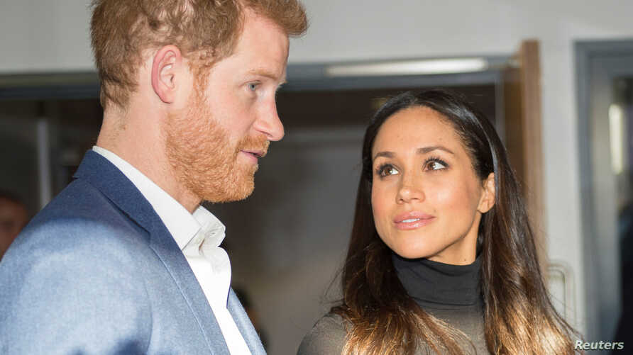 FILE - Prince Harry and fiancee Meghan Markle in London.