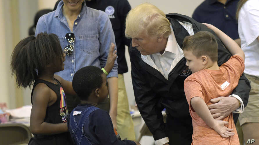 President Donald Trump and Melania Trump meet people affected by Hurricane Harvey during a visit to the NRG Center in Houston, Texas, Sept. 2, 2017. It was his second trip to Texas in a week, and his first order of business was to meet with those aff
