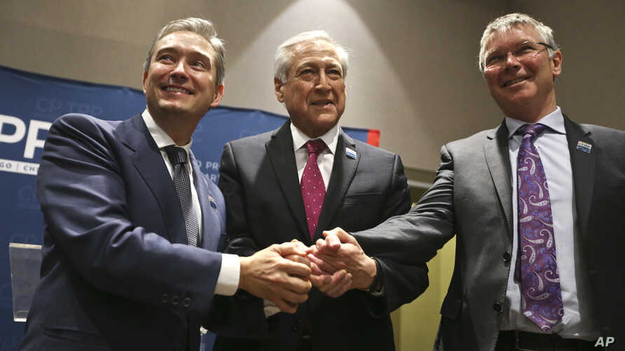 Canada's Minister of International Trade Francois-Philippe Champagne, Chile's Foreign Minister Heraldo Munoz and New Zealand's Trade Minister David Parker, pose for a photographers before a signing ceremony of the Comprehensive and Progressive Agreem...