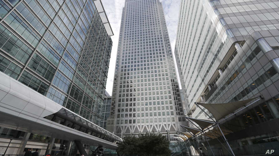 FILE - In this July 28, 2017 photo, is One Canada Square house, center, that hosts the offices of the European Banking Authority EBA, headquarters in London.