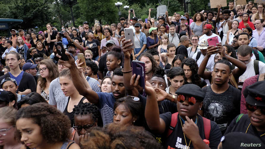 Black Lives Matter supporters, protesting the police killings of Alton Sterling and Philandro Castile days earlier, march along Manhattan streets in New York, July 8, 2016.