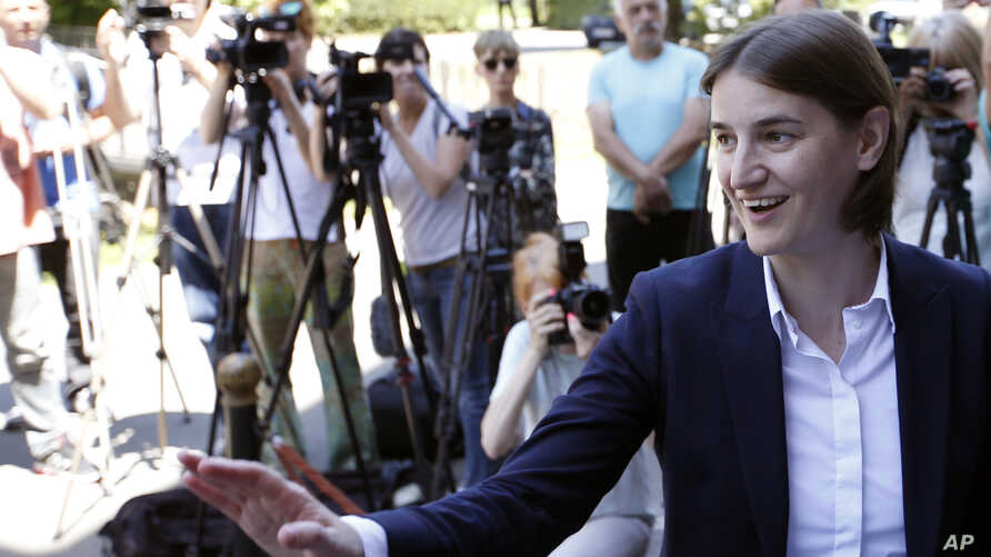 FILE - Ana Brnabic, nominated as the prime minister-designate arrives at the municipality building and waves to her supporters in Vrnjacka Banja, Serbia, June 16, 2017.
