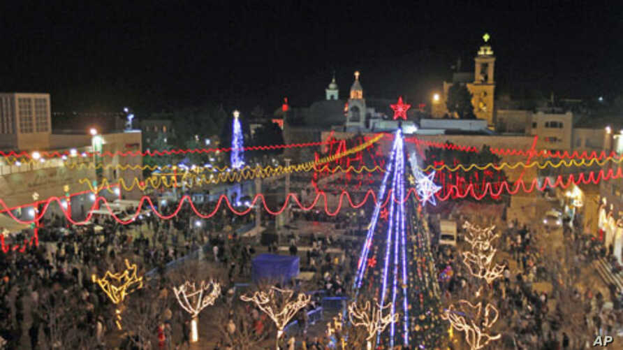 A general view shows celebrations for Christmas near the Church of the Nativity in West Bank town of Bethlehem, December 24, 2011.