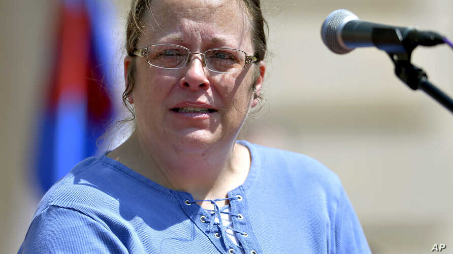 Rowan County Kentucky Clerk Kim Davis speaks to a gathering of supporters during a rally on the steps of the Kentucky State Capitol in Frankfort Ky., Saturday, Aug. 22, 2015.