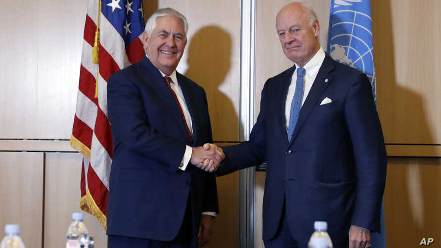 Secretary of State Rex Tillerson, left, shakes hands with U.N. Special Envoy for Syria Staffan de Mistura before their meeting on Oct. 26, 2017, in Geneva.
