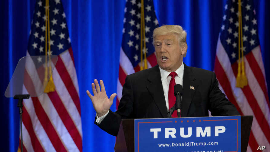 Republican presidential candidate Donald Trump looks towards a teleprompter as he speaks in New York, June 22, 2016. Trump launched a blistering verbal attack against his Democratic rival Hillary Clinton a day after she blasted him on his economic re