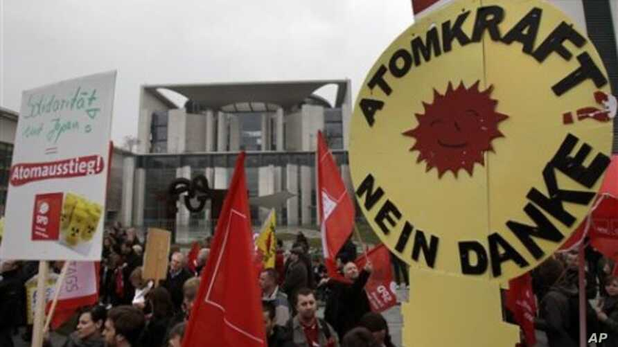 Protesters against nuclear energy demonstrate in front of the chancellery in Berlin, Germany, March 14, 2011
