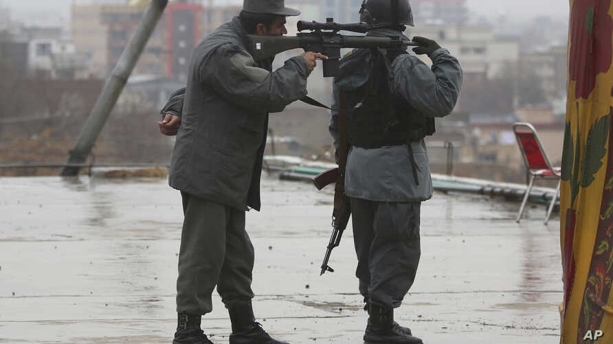 Police soldiers guard during celebrations of Nowruz, the Persian new year, at the Kart-e-Sakhi shrine in Kabul, Afghanistan, March 21, 2017.