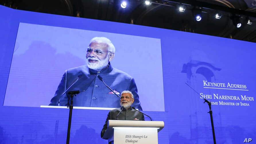India's Prime Minister Narendra Modi delivers a keynote address at the opening dinner of the 17th IISS Shangri-la Dialogue, an annual defense and security forum in Asia, in Singapore, June 1, 2018, in Singapore.