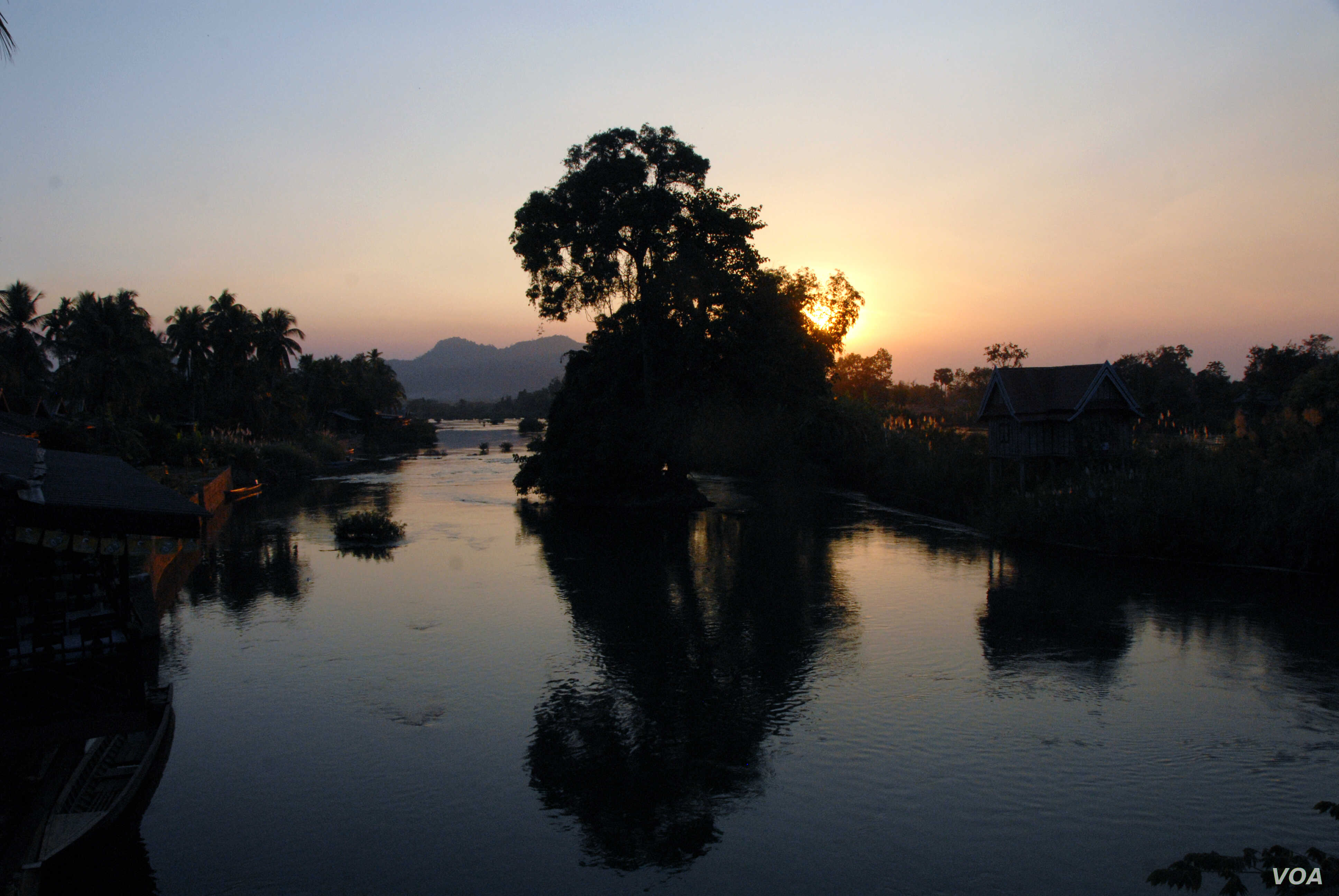 Sunset over the Mekong River from Don Khone where many locals fear they might be displaced if the dam at nearby Don Sahong goes ahead. (Luke Hunt for VOA News)
