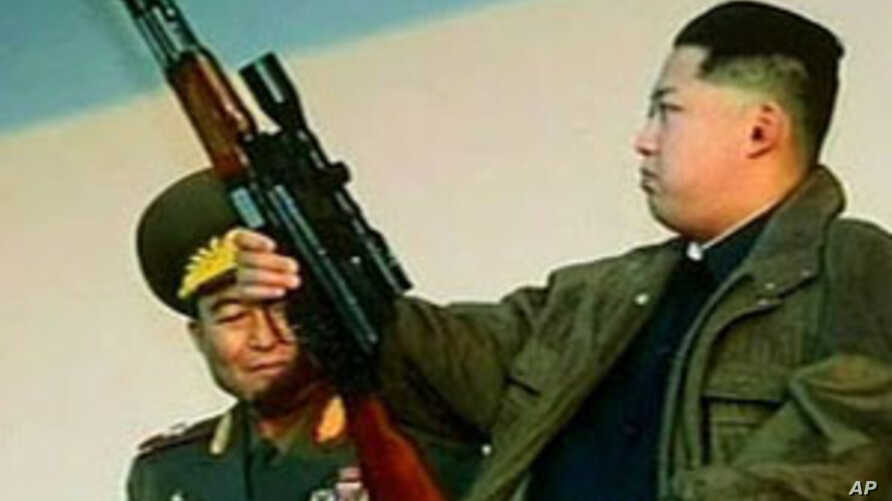 Kim Jong Un holds an assault rifle, equipped with a sniper's scope, in a scene from a program broadcast Sunday on North Korean television.