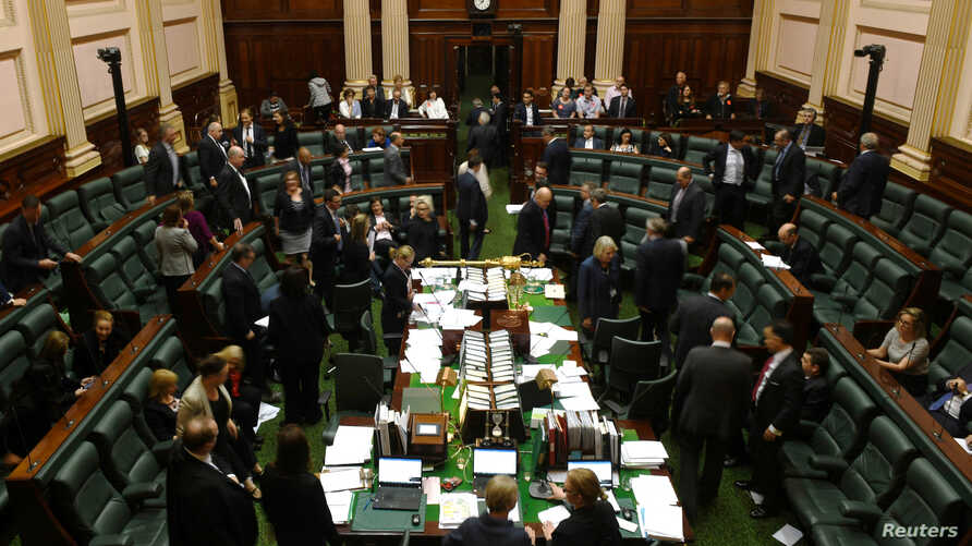 Members of parliament from the Australian state of Victoria participate in a marathon sitting to discuss a euthanasia bill in Melbourne, Australia, Oct. 20, 2017.