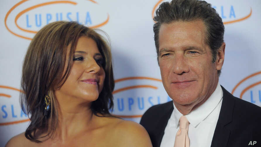 FILE - Honorees Glenn Frey and his wife, Cindy, arrive at the 10th Annual Lupus LA Orange Ball in Beverly Hills, Calif., May 6, 2010.
