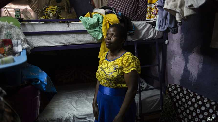 FILE - Margaret Oliele, a former detained patient, poses for a portrait in her home in Nairobi, Kenya, Sept. 8, 2018.
