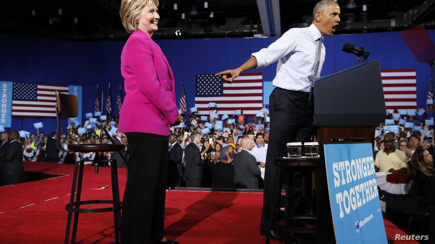 U.S. President Barack Obama points to Democratic U.S. presidential candidate Hillary Clinton during a Clinton campaign event in Charlotte, N.C., July 5, 2016.