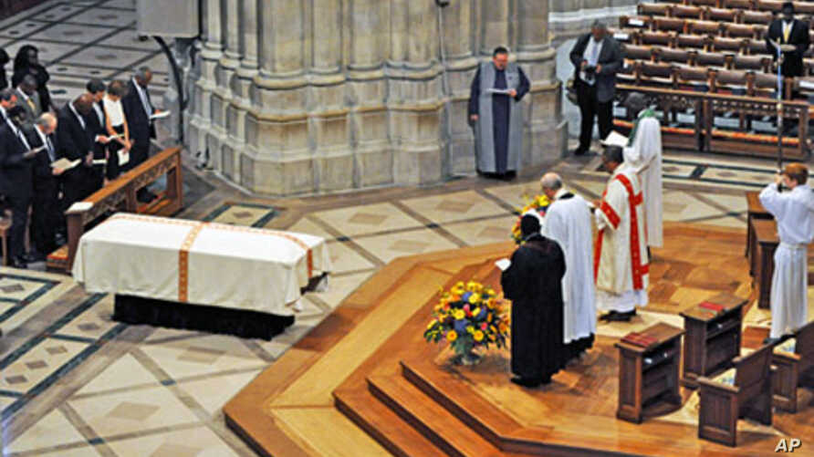 Manute Bol's casket lies at the Washington National Cathedral during funeral services for the late NBA star, 29 Jun 2010