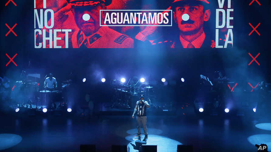 Singer-songwriter Rene Perez Joglar, also known as Residente, performs during his concert at the Auditorio Nacional in Mexico City, Saturday, June 17, 2017. Puerto Rican rapper Residente's first solo album post-Calle 13 has received a leading nine no