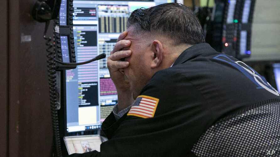 Trader Jonathan Mueller works in his booth on the floor of the New York Stock Exchange, Oct. 26, 2018.