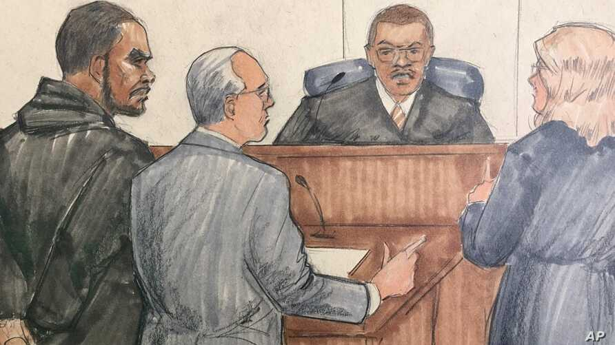 In this courtroom sketch, from left, R&B singer R. Kelly, attorney Steve Greenberg, Cook County Judge John Fitzgerald Lyke Jr. and prosecutor Jennifer Gonzalez are shown at the Leighton Criminal Courthouse, Feb. 23, 2019 in Chicago.