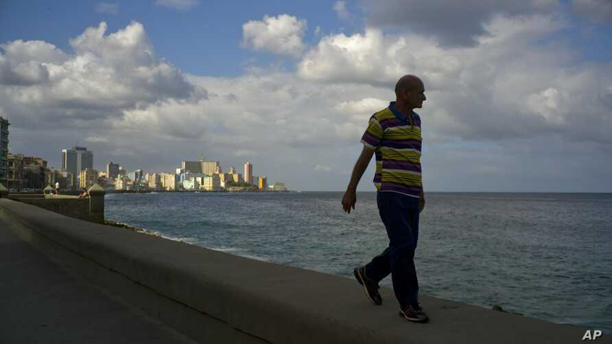 A man walks along the sea wall of Havana, Cuba, Jan. 13, 2017.