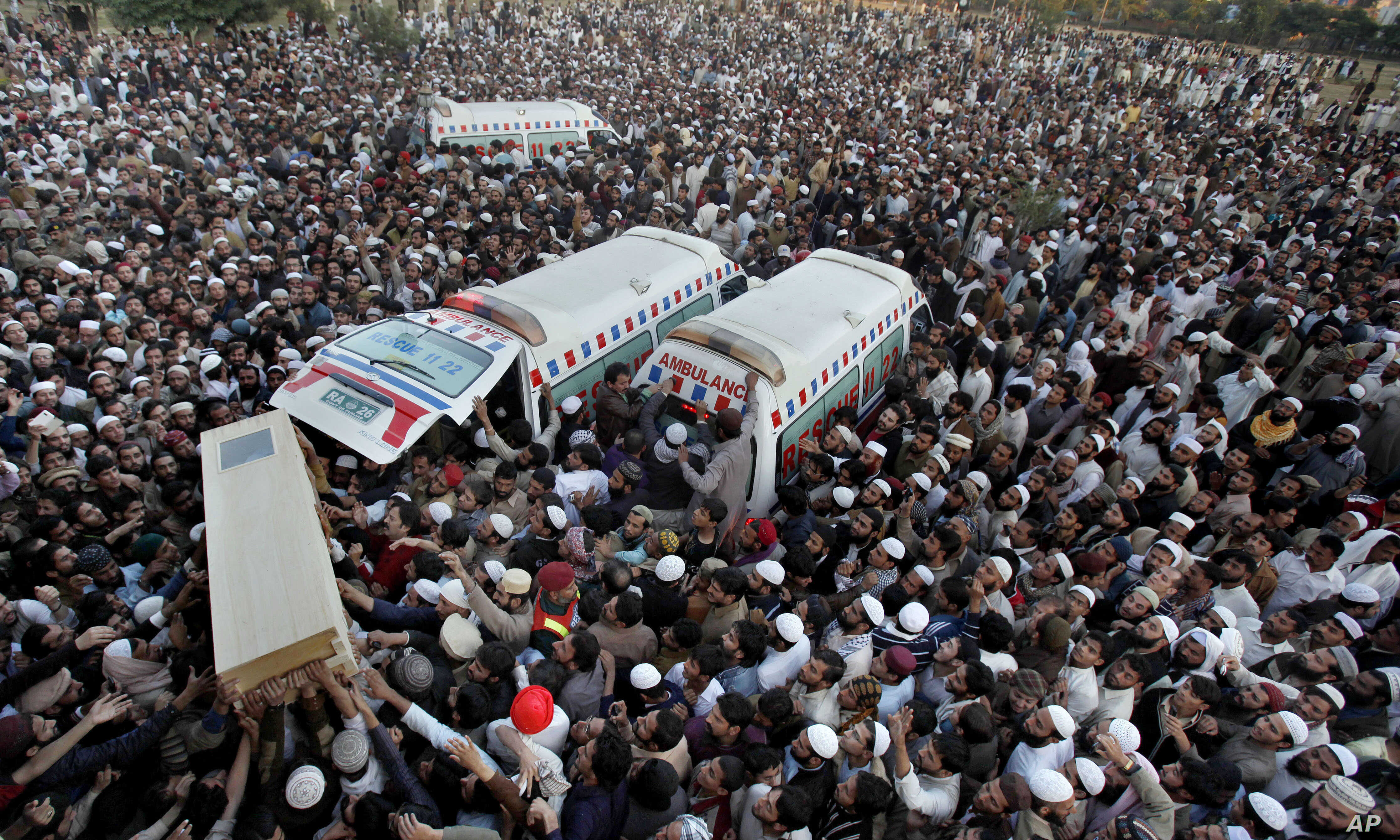 Pakistani Sunni Muslims carry the casket of a victim of Friday's sectarian clashes during funeral prayers in Rawalpindi, Pakistan,  Nov. 17, 2013.