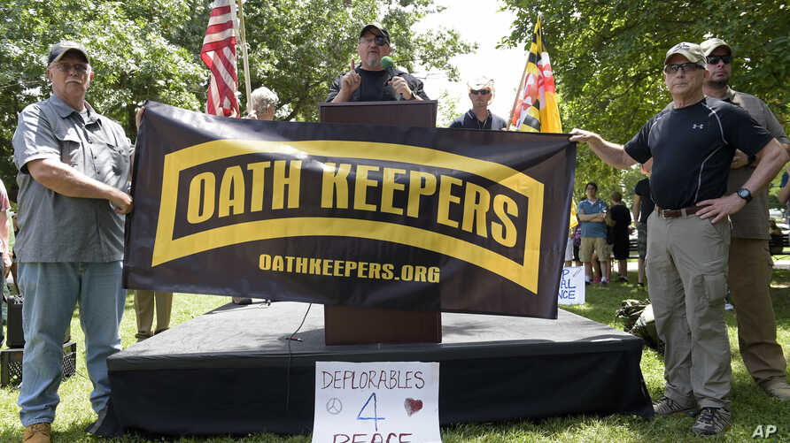 Stewart Rhodes, founder of the citizen militia group known as the Oath Keepers, center, speaks during a rally outside the White House in Washington, June 25, 2017.