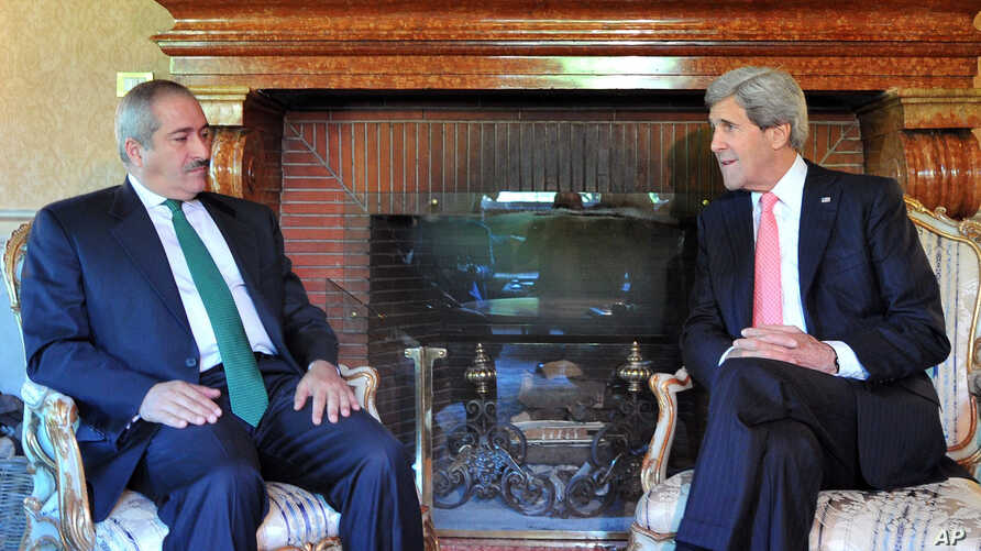 U.S. Secretary of State John Kerry, right, speaks to Jordanian Foreign Minister Nasser Judeh during a meeting at the U.S. ambassador's residence in Rome, May 9, 2013.