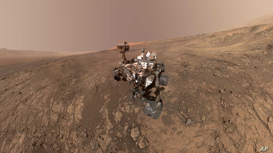 This composite image made from a series of Jan. 23, 2018 photos shows a self-portrait of NASA's Curiosity Mars rover on Vera Rubin Ridge. The rover's arm which held the camera was positioned out of each of the dozens of shots which make up the mosaic