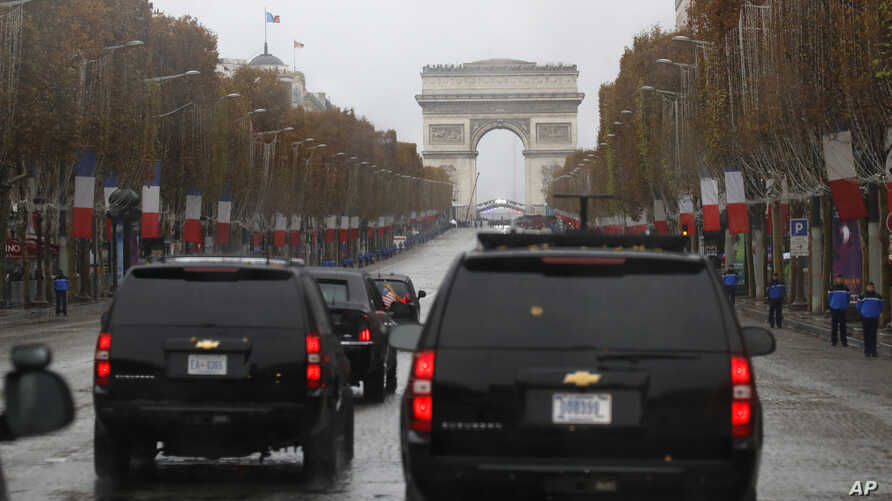 The motorcade of President Donald Trump drives up the Champs Elysees to an Armistice Day Centennial Commemoration at the Arc de Triomphe, Nov. 11, 2018, in Paris.