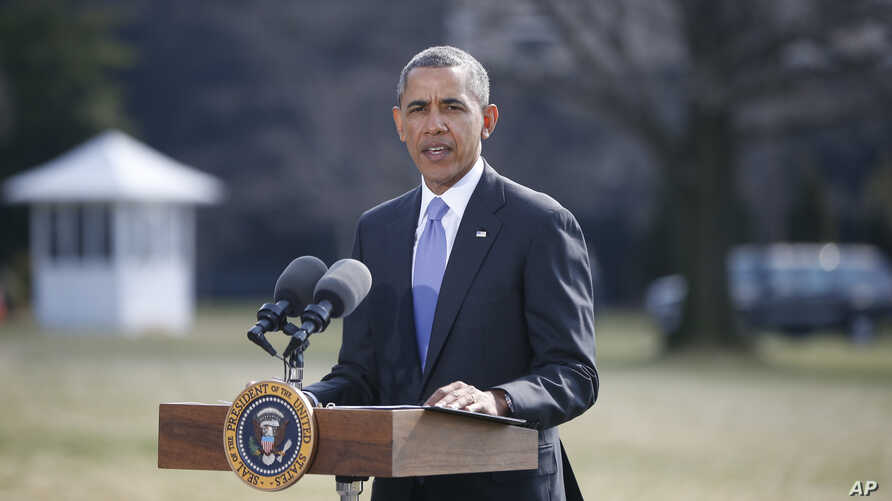 President Barack Obama makes a statement on Ukraine, March 20, 2014, on the South Lawn at the White House in Washington.
