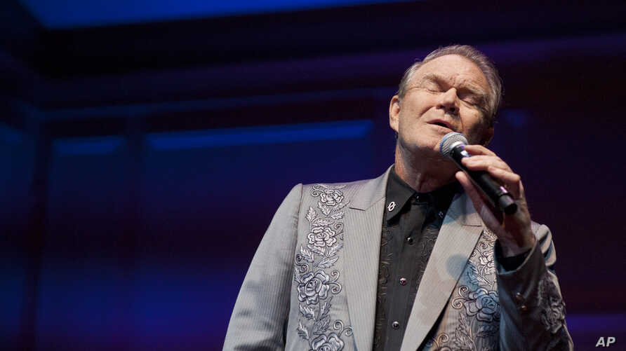 FILE - American Music Legend Glen Campbell performs at the Alzheimer's Association Evening with Glenn Campbell at the Library of Congress on Capitol Hill in Washington, May 16, 2012.