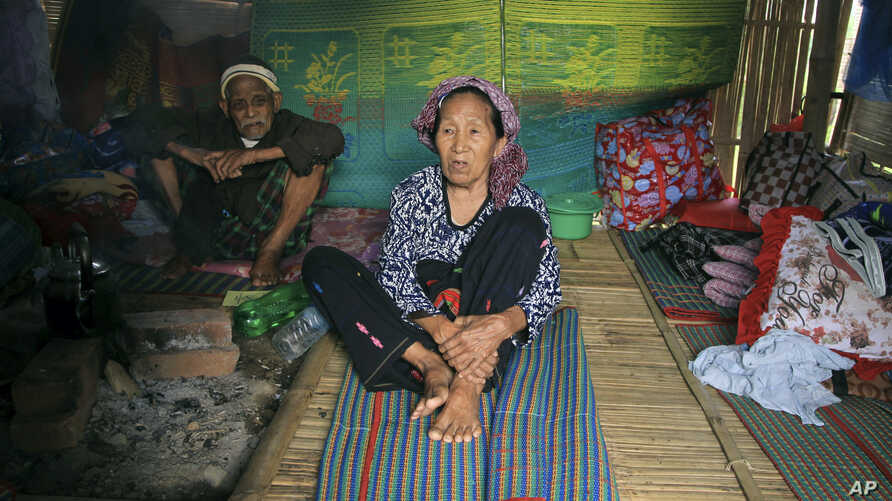ethnic Kachin Nlam Numrang Doi, 92, sits along with her husband Hkaraw Yaw, 102, at their hut in compound of Trinity Baptist Church refugee camp for internally displaced people in Myitkyina, Kachin State, northern Myanmar, May 6, 2018.