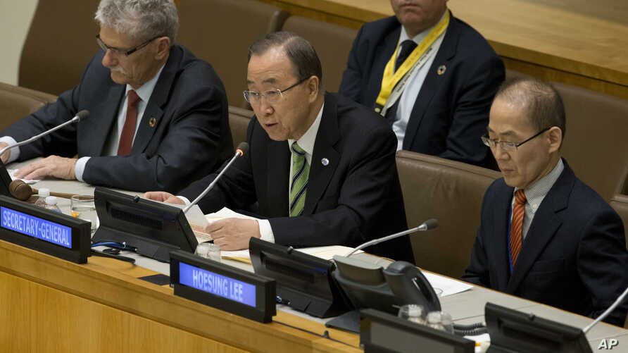 U.N. Secretary-General Ban Ki-moon, center, is joined by Intergovernmental Panel on Climate Change Chairman Hoesung Lee, right, and U.N. General Assembly President Mogens Lykketoft as he speaks during a high-level meeting on the Implementation of the