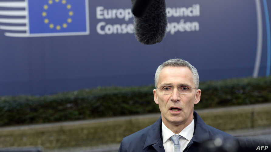 NATO Secretary General Jens Stoltenberg talks to the media upon his arrival to attend a European Union summit at the European Council building in Brussels on Dec. 15, 2016.