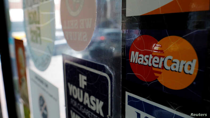 FILE - A sticker shows that a store accepts MasterCard in Harvard Square in Cambridge, Massachusetts, U.S.