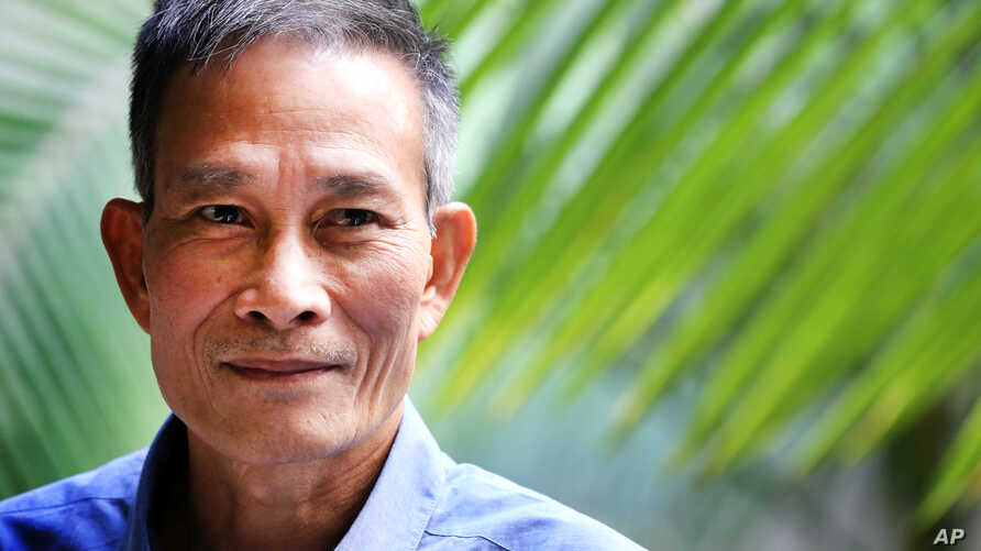 """FILE - Vietnamese blogger Nguyen Van Hai, pictured in October 2014, says it's time """"for everyone to sit down to find ways to restore"""" his country, but """"everyone must have a voice in the process."""""""