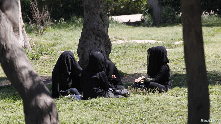 Veiled women sit as they chat in a garden in the northern province of Raqqa March 31, 2014. The Islamic State in Iraq and the Levant (ISIL) has imposed sweeping restrictions on personal freedoms in the northern province of Raqqa. Among the restrictio