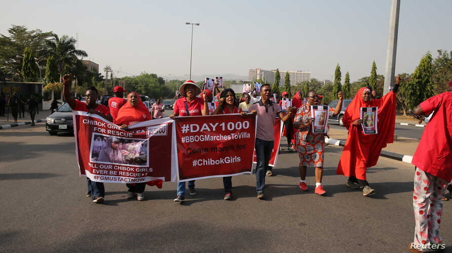 Members of the #BringBackOurGirls campaign rally in Nigeria's capital Abuja to mark 1,000 days since over 200 schoolgirls were kidnapped from their secondary school in Chibok by Islamist sect Boko Haram, Nigeria Jan. 8, 2017.