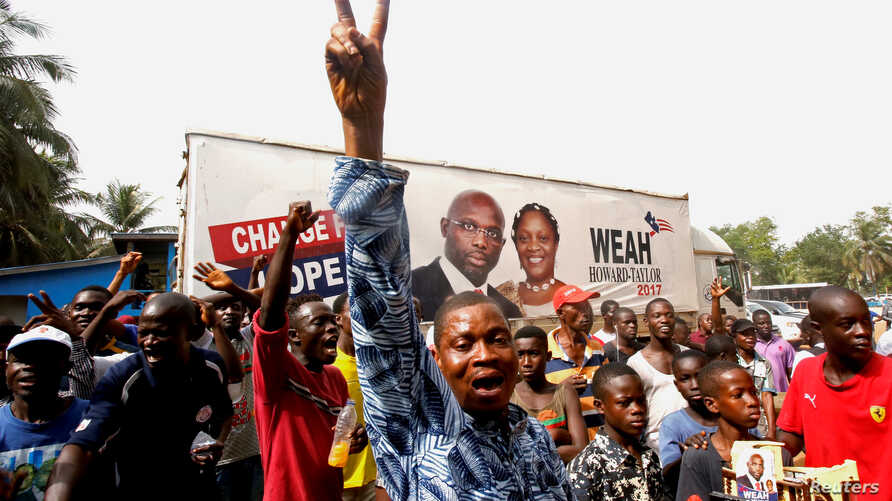 Supporters of George Weah, former soccer player and presidential candidate of Coalition for Democratic Change (CDC), celebrate after the announcement of the presidential election results in Monrovia, Liberia, Dec. 28, 2017.