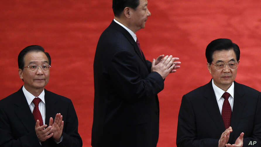 Chinese President Hu Jintao, right, Premier Wen Jiabao, left, and Vice President Xi Jinping, in Beijing, (May 4, 2012 file photo)