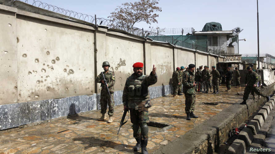 Afghan National Army soldiers keep watch at the site of attack in Kabul March 9, 2013.
